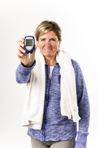 Diabetic woman holds up a glaucometer