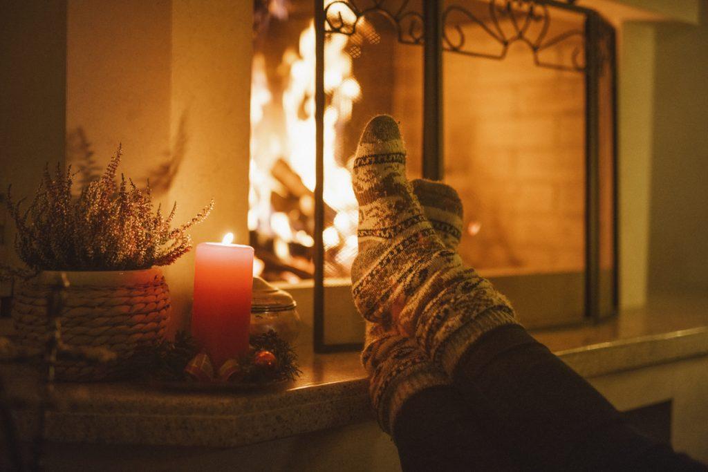cozy stockinged feet by fireplace
